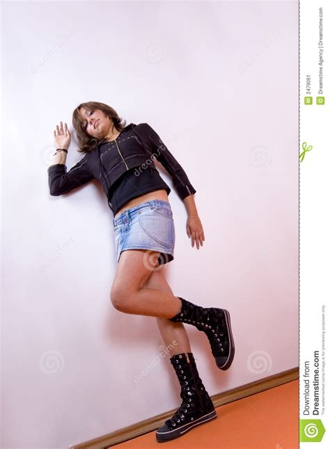 Girl Leaning On Wall Stock Image - Image: 2479061